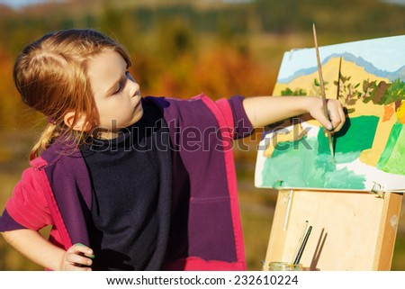 little painter at work with palette