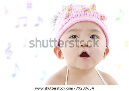 Little pan Asian girl singing happily - stock photo