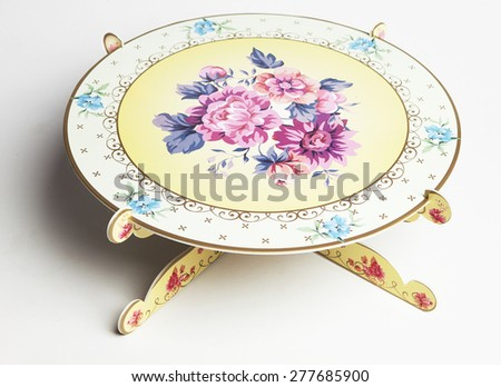 Little paper table for parties with beautiful ornaments as decoration - stock photo