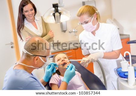 Little patient at the dentist have teeth checkup stomatology clinic - stock photo