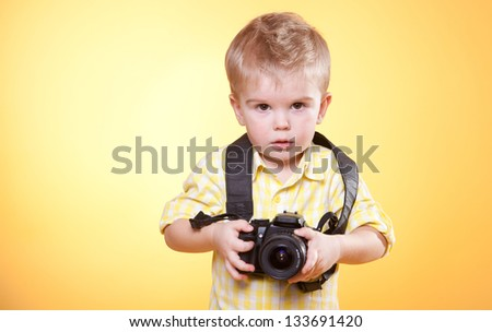 little  photographer with professional photo camera - stock photo