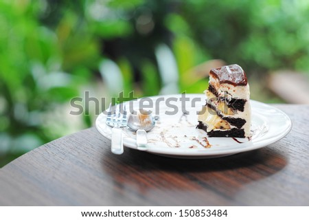 Little pice of chocolate cake with banana. - stock photo