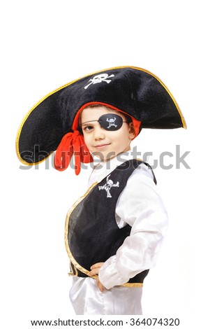 Little pirate boy is posing to the camera while his hands on waist. Isolated on white. - stock photo