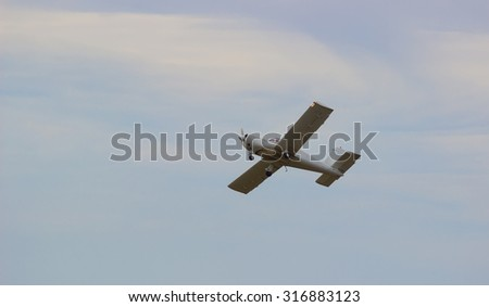 little plane in the air. Small aircraft