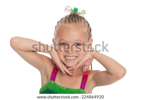 Little playful girl with a charming smile. Girl is six years old. - stock photo