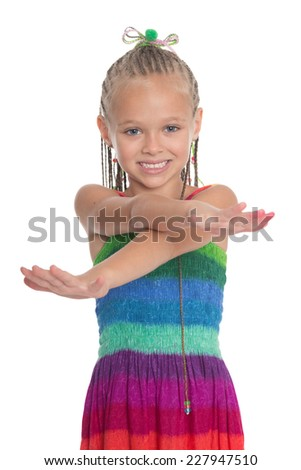 Little playful girl with crossed hands in front. Girl is six years old. - stock photo