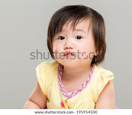 Little pouting baby girl - stock photo