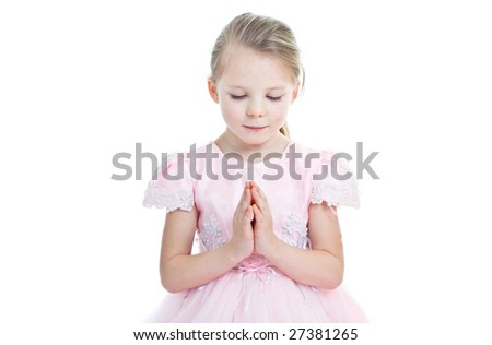 little praying girl in pink dress with her eyes closed - stock photo
