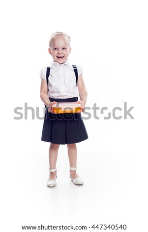 Little preschool girl hold lunch box in the hands, preparing for the school, isolated on white background. - stock photo