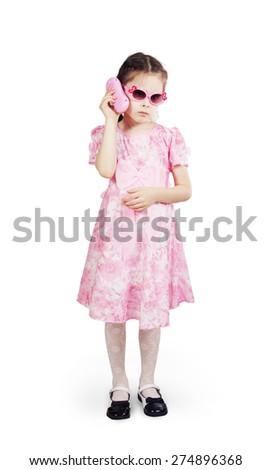 Little pretty girl wearing beautiful pink dress - stock photo