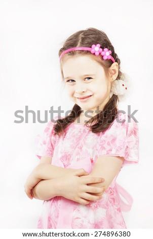 Little pretty girl wearing beautiful pink dress is smiling - stock photo