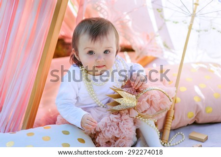 Little princess baby girl celebrate her birthday party outdoor - stock photo
