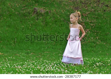Little princess on the lawn - stock photo