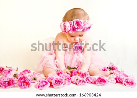 Little princess with a crown of roses - stock photo