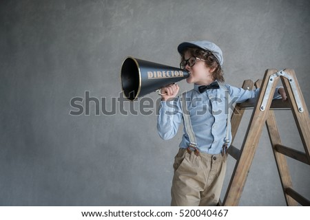 Little producer with a megaphone