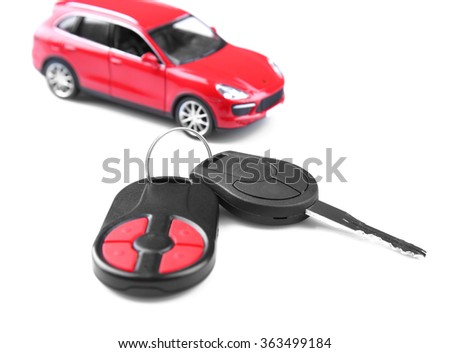 Little red car with key isolated on white background - stock photo