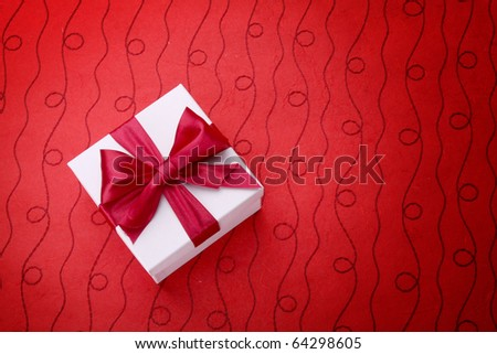 Little red gift on red background