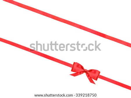 little red satin bow and two diagonal ribbons isolated on horizontal white background