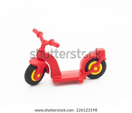 Little red toy scooter - stock photo