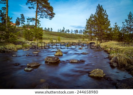 Little river in mountain. Long exposure scene / Mountain River  - stock photo