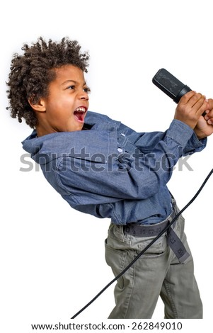 Little rocker emotionally singing into a microphone. - stock photo