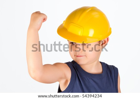 little roughneck showing his muscles - stock photo