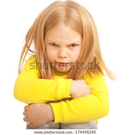 Little sad and angry child. Isolated on white background - stock photo