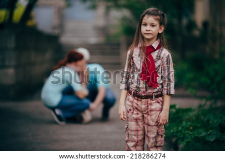 little sad and serious girl stay alone in park