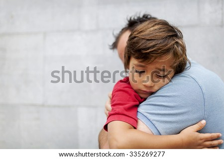 Little sad boy whith his dad