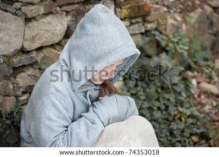 Little sad child is lonesome. - stock photo