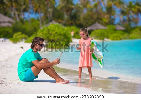 Little sad girl waiting for dad to swim until he working - stock photo