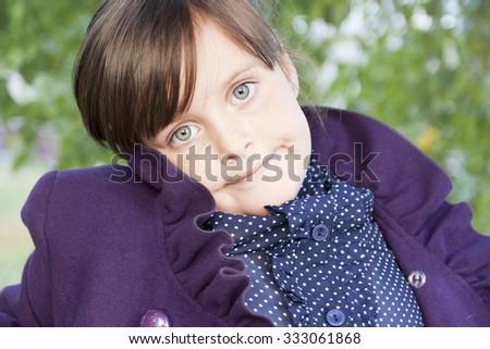 little sad schoolgirl coat autumn - stock photo