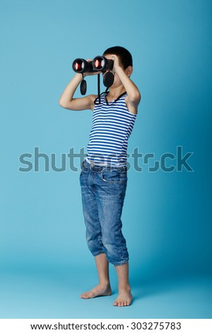 little sailor with binoculars on sky blue background