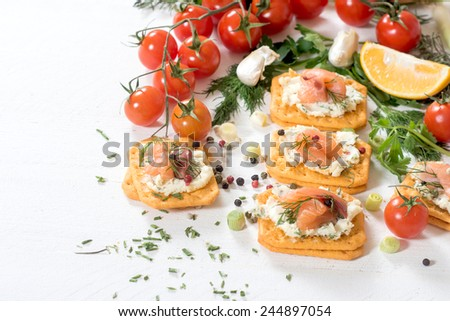 Little salmon crackers sandwiches with creamy cheese,selective focus  - stock photo