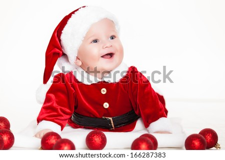 little santa baby with christmas hat lying over white background