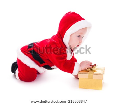 Little Santa boy with gold gift box isolated on white