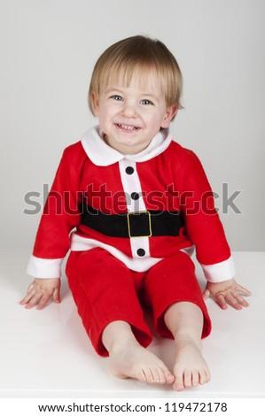 Little Santa Christmas boy smiling - stock photo