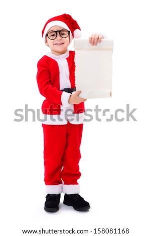 Little Santa Claus boy wearing big glasses, showing blank wish list - stock photo