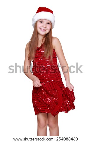 little santa girl dancing isolated on Holiday theme/kid girl dancing with red dress and santa red and white hat on white background - stock photo