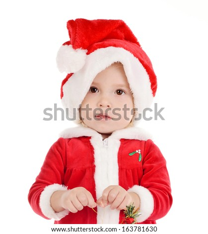 little Santa girl with toys for tree