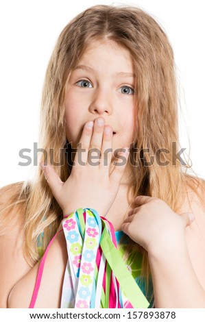 Little school girl looking at camera surprised isolated on white portrait - stock photo