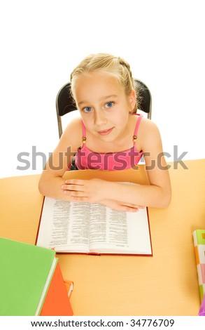 Little schoolgirl reading a book - stock photo