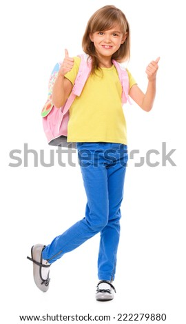 Little schoolgirl with a backpack showing thumb up sign, isolated over white - stock photo