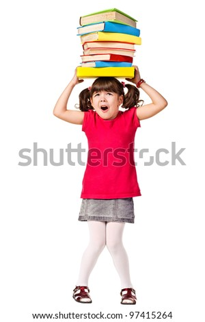 Little schoolgirl with a stack of heavy books on head. Isolated over white - stock photo