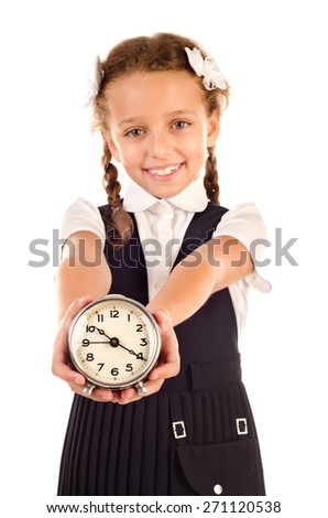 little schoolgirl with clock isolated on a white background - stock photo