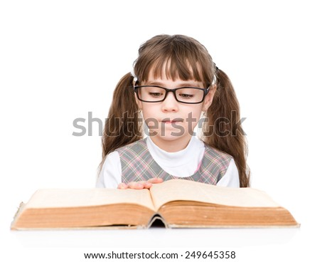 little schoolgirl with glasses read book. isolated on white background - stock photo