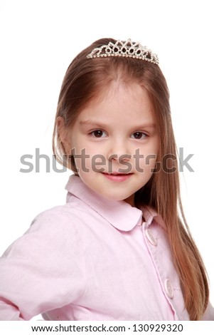 Little schoolgirl with long healthy hair on Beauty and Fashion