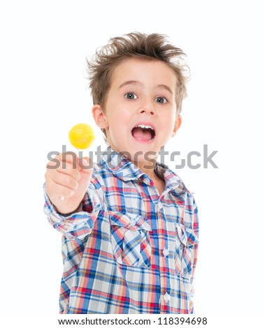 Little screaming excited boy with lollipop in hand isolated on white - stock photo