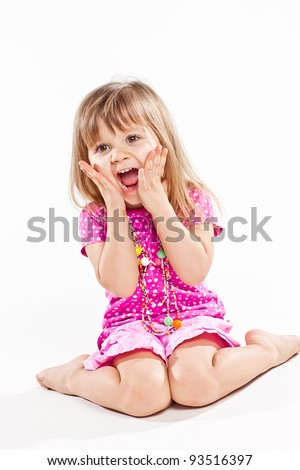 Little screaming girl with both eyes closed isolated over white background