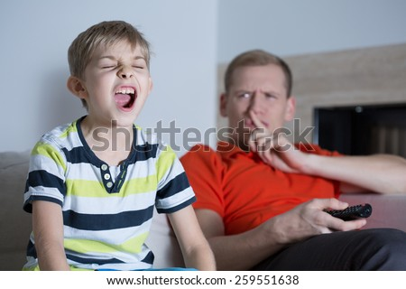 Little screaming son and his annoyed young father - stock photo